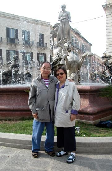 Trip to Sicily, in front of mathematician Archimedes memorial fountain (2004)